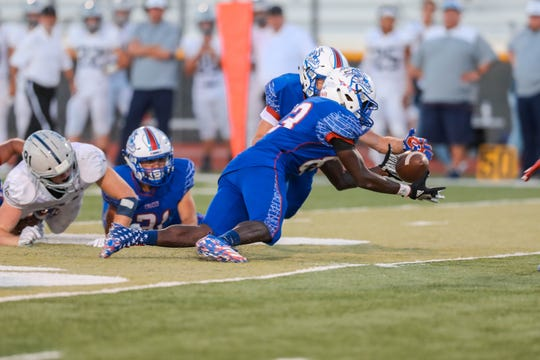 Senior defensive back Jonathan McRae (83) recovers a fumble as the Las Cruces Bulldawgs and the La Cueva Bears from Albuquerque face off at the Field of Dreams in Las Cruces on Friday, Sept. 6, 2019.