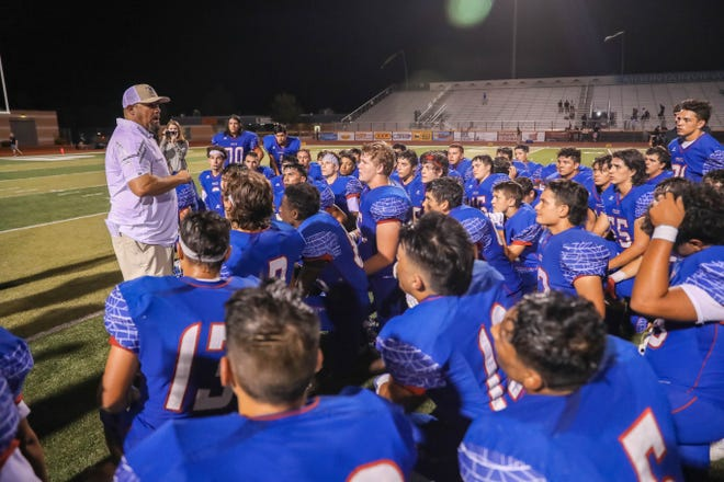 The Las Cruces Bulldawgs are spoken to by head coach Mark Lopez after facing off against La Cueva Bears from Albuquerque at the Field of Dreams in Las Cruces on Friday, Sept. 6, 2019.