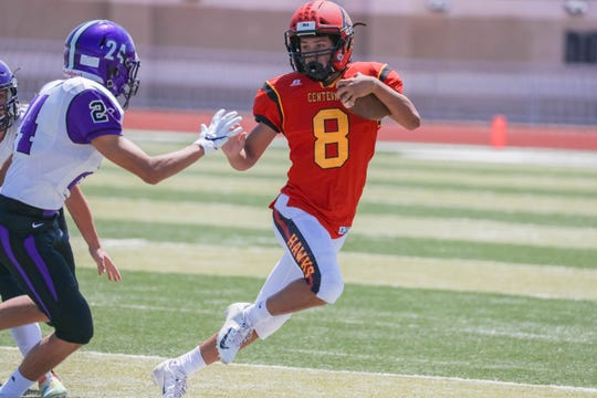 Junior cornerback Karsten Rueckner (8) runs the ball as the Centennial Hawks face off against the Manzano Monarchs from Albuquerque at the Field of Dreams in Las Cruces on Saturday, Sept. 7, 2019.