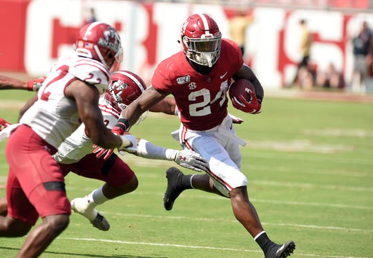 Sep 7, 2019; Tuscaloosa, AL, USA; Alabama Crimson Tide running back Brian Robinson Jr. (24) carries the ball against the New Mexico State Aggies during the first quarter at Bryant-Denny Stadium. Mandatory Credit: John David Mercer-USA TODAY Sports