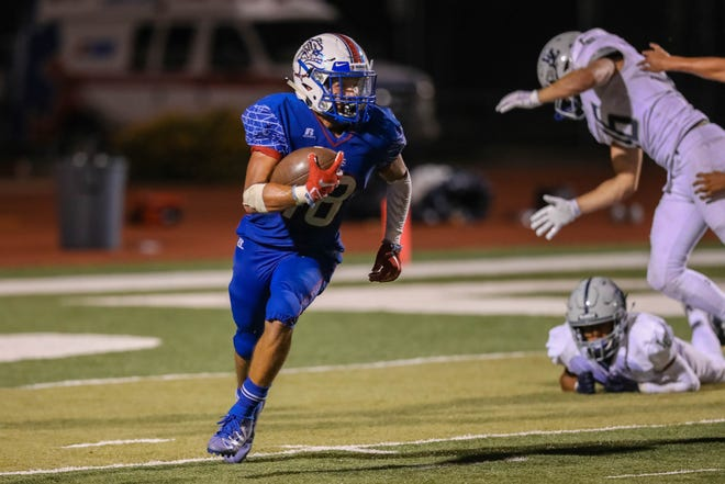 Senior wide receiver Israel Ramirez (18) receives and runs the ball as the Las Cruces Bulldawgs and the La Cueva Bears from Albuquerque face off at the Field of Dreams in Las Cruces on Friday, Sept. 6, 2019.