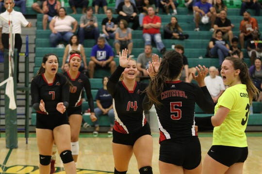 Centennial players celebrate a point. The Cenntennial Hawks played the Cleveland Storm in the Sweet 16 Tournament championship game on September 7, 2019.