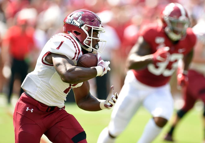 Sep 7, 2019; Tuscaloosa, AL, USA; New Mexico State Aggies running back Jason Huntley (1) carries the ball against the Alabama Crimson Tide during the first quarter at Bryant-Denny Stadium. Mandatory Credit: John David Mercer-USA TODAY Sports
