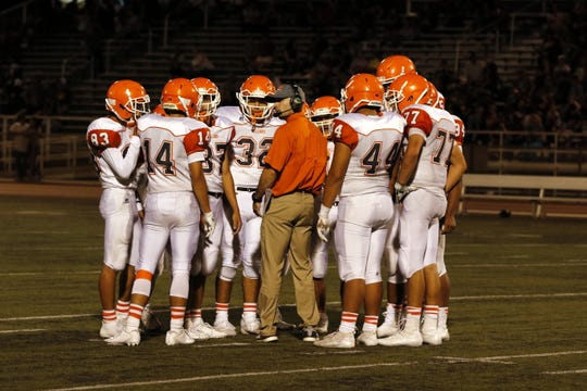 The Bulldogs defense talks during a timeout against Belen on Sept. 6, 2019. After two straight weeks of facing spread offenses, the Artesia Bulldogs face the 50/50 offense of the Deming Wildcats this Friday on the road.