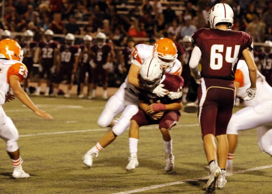 Artesia's Wesley Knowlton brings down a Belen receiver on Sept. 6, 2019.