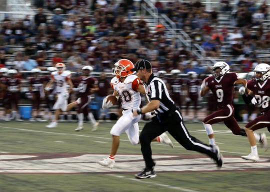 Artesia's Braxton McDonald outruns everyone during his 91-yard touchdown reception against Belen. He finished with three scores and Artesia won, 56-14.