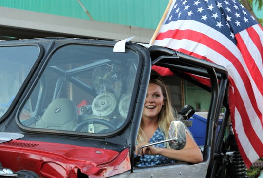 Emily Bayliss of England sits inside a rig owned by Bloomfield resident Andy Valdez.