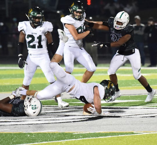 Groves senior running back Colby Taylor fights for yardage against West Bloomfield.