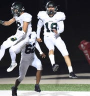 Groves wide receiver Eli Turner celebrates after scoring the winning touchdown against West Bloomfield.