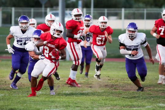 Jason Roberts of Palm Springs High School runs the ball during a game versus St. Anthony in Palm Springs, Calif. on Friday, September 6, 2019.