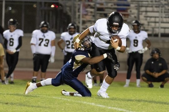 Darian Johnson of Desert Hot Springs tackles quarterback Ivan Carrillo of Arroyo Valley on Sept. 6, 2019.