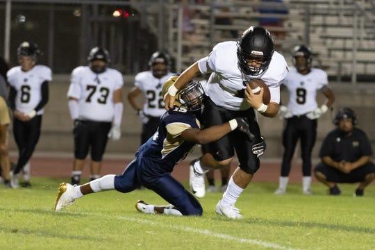 Darian Johnson of Desert Hot Springs tackles quarterback Ivan Carrillo of Arroyo Valley on Sept. 6, 2019.