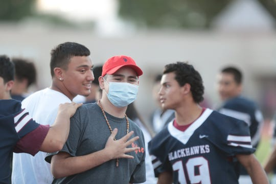 La Quinta's junior offensive lineman, Max Borbon, places his hand over his heart in a gesture to thank the crowd for their cheers for him prior to the game against Coachella Valley at La Quinta High in La Quinta, Calif., on Friday, September 6, 2019. Borbon is recovering from leukemia.