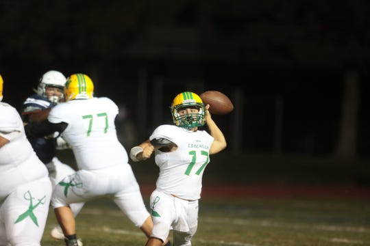 Coachella Valley High quarterback Jacob Calderon throws the ball during the game against La Quinta in La Quinta, Calif., on Friday, September 6, 2019.