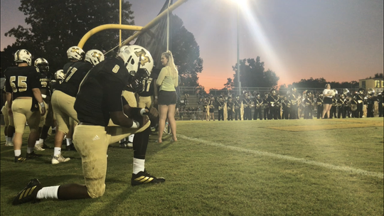 Milton freshman wide receiver Raymond Cottrell kneels in prayer prior to the Panthers' game against Navarre on Sept. 6, 2019. Cottrell caught his first career touchdown pass in the fourth quarter.