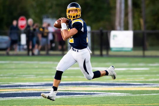 Littlestown quarterback Zach Ressler floats in the air as he rolls out of the pocket to pass during a YAIAA football game against Eastern York at Thunderbolt Stadium on Friday, September 6, 2019.