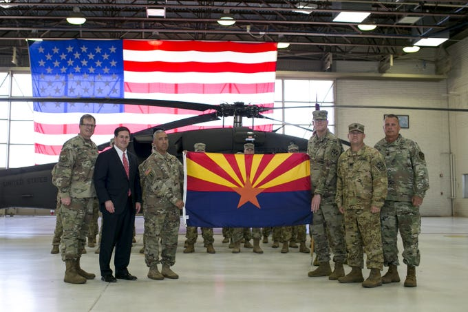 The Arizona flag is presented to members of an Army National Guard detachment unit at a deployment ceremony at the Army Aviation Support Facility at Papago Park Military Reservation in Phoenix on Sept. 6, 2019.
