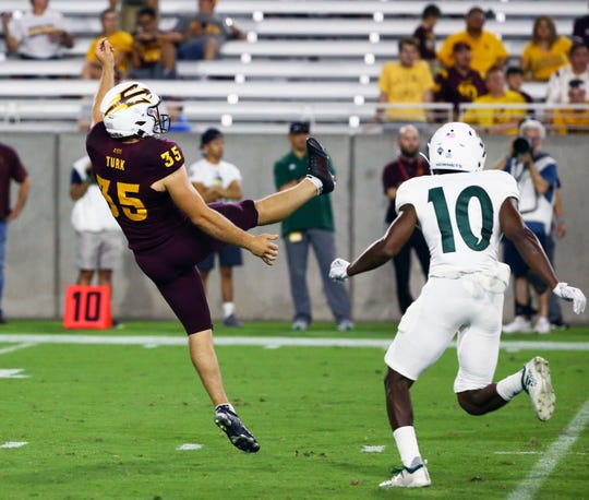 Arizona State Sun Devils punter Michael Turk (35) kicks the ball to Sacramento State in the second half during a game at Sun Devil Stadium on Sep. 6, 2019 in Tempe, Ariz.