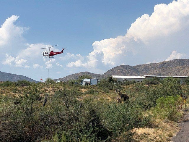 Air and ground crews were helping to fight the River Fire north of Phoenix, which had grown to 4,800 acres late Friday.