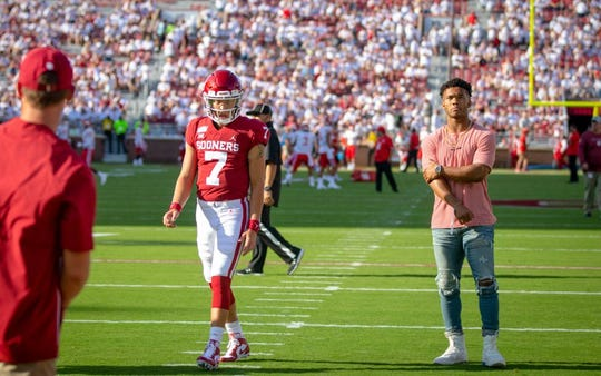 Former Oklahoma quarterback Kyler Murray (right) stands next to current Oklahoma quarterback Spencer Rattler (7) as Rattler warms up for the first game of the 2019 season.