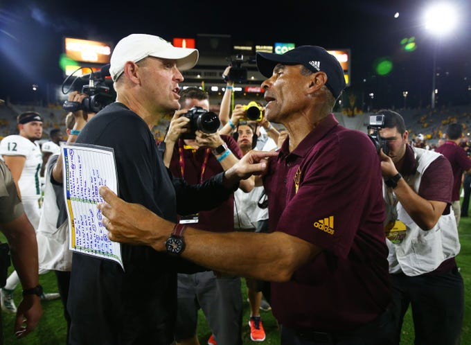 Sacramento State head coach Troy Taylor greets Arizona State head coach Herm Edwards after the Sun Devils won 19-7 during a game at Sun Devil Stadium on Sep. 6, 2019 in Tempe, Ariz.
