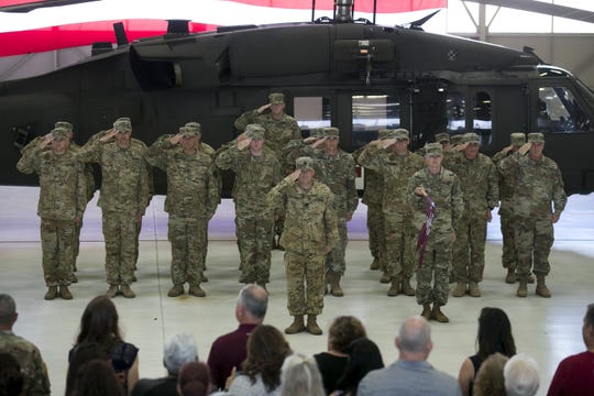Members of an Army National Guard detachment unit bid farewell at Papago Park Military Reservation in Phoenix on Sept. 6, 2019.