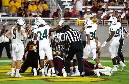 Sacramento State recovers the fumble in the end zone by Arizona State Sun Devils running back A.J. Carter in the first half during a game at Sun Devil Stadium on Sep. 6, 2019 in Tempe, Ariz.