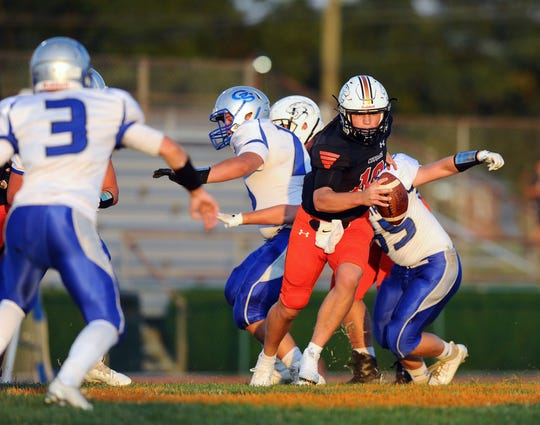 Palmyra QB Stephen Lyons (10) rolls out of the pocket during first quarter action in the game between the Palmyra H.S. Cougars and the Garden Spot H.S. Spartans played Friday Sept.6,2019 at Palmyra's Buck Swank Stadium.