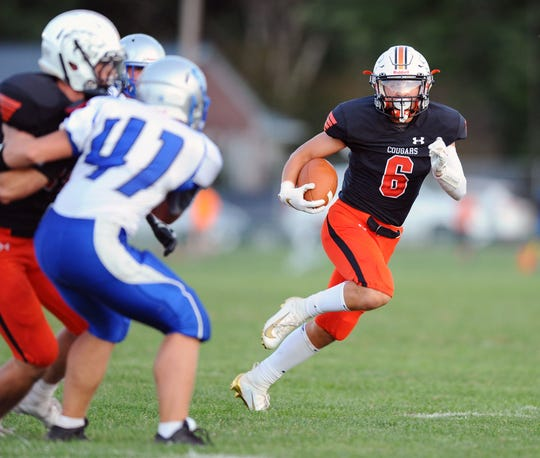 Palmyra's Kasey Shughart (6) returns a punt that help set up his team's first touchdown of the game in the game between the Palmyra H.S. Cougars and the Garden Spot H.S. Spartans played Friday Sept.6,2019 at Palmyra's Buck Swank Stadium.