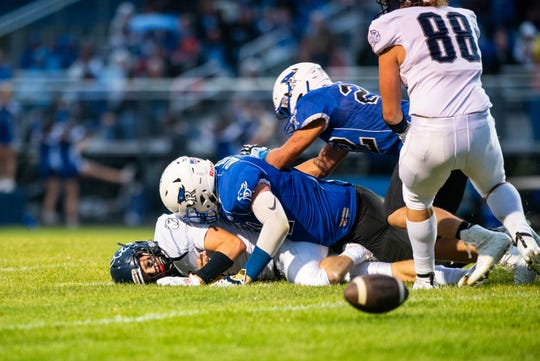 Yale quarterback Jacob Craig (bottom) loses the football after being sacked by Cros-Lex's Tyler Black during their game Friday, Sept. 6, 2019, at Cros-Lex High School.
