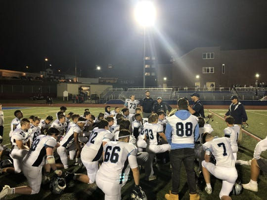 John Jay-East Fishkill in a huddle after their 14-7 win over Carmel on Friday, Sept. 6 2019.