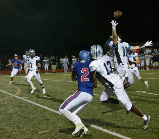 John Jay safety Luke Mahon leaps to make a play on the ball against Carmel during a game last Friday.