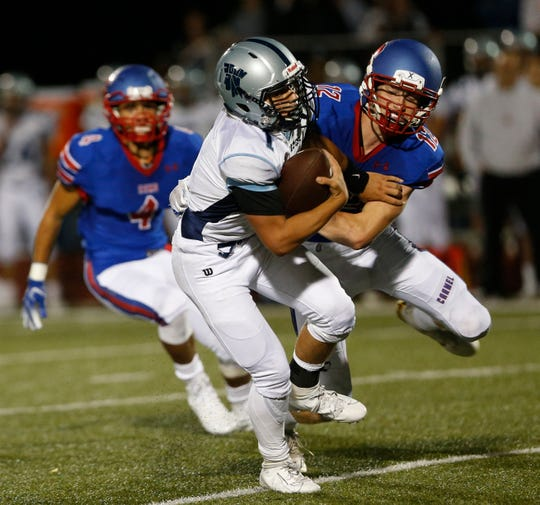 John Jay's Danny Beal attempts to break free from Carmel's Will Boalt during Friday's game versus Carmel on September 6, 2019.