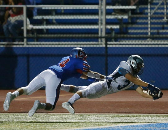 John Jay's Brayden Rossi dives toward the end zone during a Sept. 6 game against Carmel.