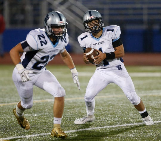 John Jay quarterback Danny Beal drops back after taking the snap, joined by Jordan Croce in the backfield during a Sept. 6 game against Carmel.