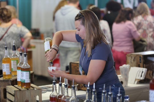 Stephanie Casey, a sales representative with Drink More Good in Beacon, pours a sample of the company's soda syrup at the Hudson Valley Wine & Food Fest in Rhinebeck on Sept. 7, 2019.