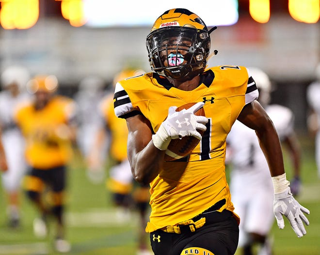 Red Lion's Davante Dennis runs 80 yard to score a touchdown during football action against Chambersburg at Horn Field in Red Lion, Friday, Sept. 6, 2019. Red Lion would win the game 26-21. Dawn J. Sagert photo