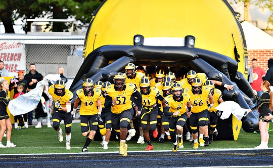 The Red Lion football team storms onto the field last Friday night against Chambersburg. The Lions have gotten off to a 3-0 start this season.