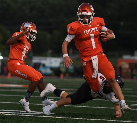 Central York's Beau Pribula (1) sprints past Hempfield's Tanner Hess (5) on Friday, September 6, 2019.