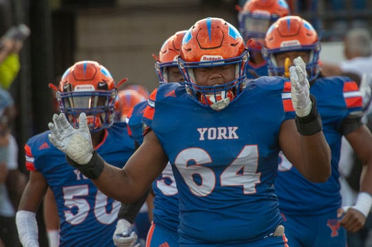 Antonio Jones Jr. leads the York High Bearcats onto the field for Friday's game against Cedar Crest.
