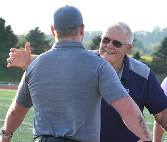 Brad Livingston embraces Head Coach Josh Oswalt Friday night before the game with Hempfield on Friday, September 6, 2019.