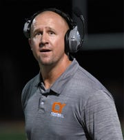 Central York's Head Coach Josh Oswalt reacts to an Official's call Friday night in the game with Hempfield.
