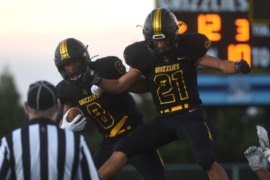 Galena's Bobby Hartley-Brown (8) celebrates with teammate Logan Shima after scoring against Reed during their football game in Reno on Sept. 6, 2019.