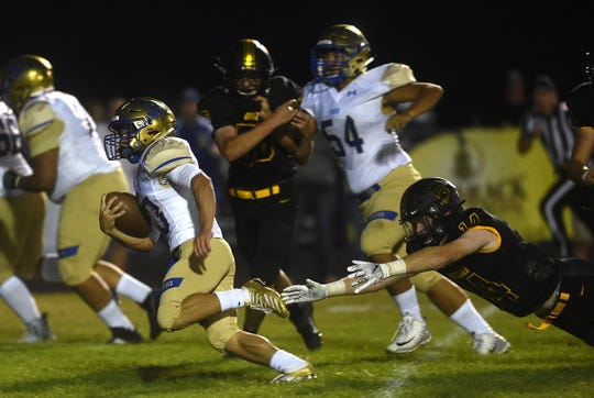 Reed's Chance Bustillos (33) runs while taking on Galena  during their football game in Reno on Sept. 6, 2019.