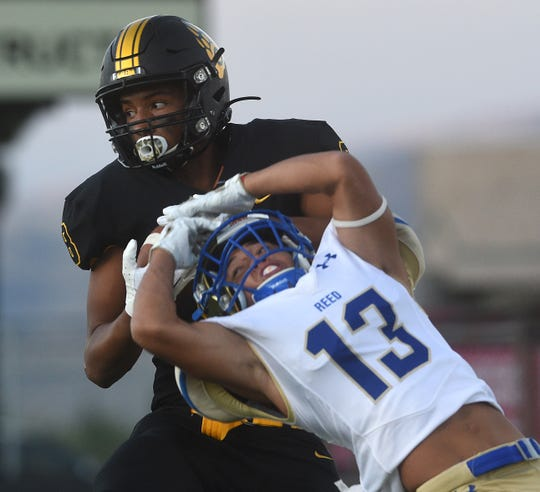 Galena's Bobby Hartley-Brown (8) hauls in a touchdown over Reed's Jared Cabales during their football game in Reno on Sept. 6.
