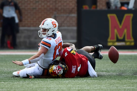 Maryland Terrapins linebacker Keandre Jones (4) forces Syracuse Orange quarterback Tommy DeVito (13) to fumble during the first half of an NCAA college football game, Saturday, Sept. 7, 2019, in College Park, Md.