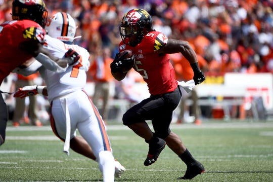 Maryland running back Anthony McFarland Jr. (5) runs the ball for a touchdown during the first half of an NCAA college football game against Syracuse, Saturday, Sept. 7, 2019, in College Park, Md.