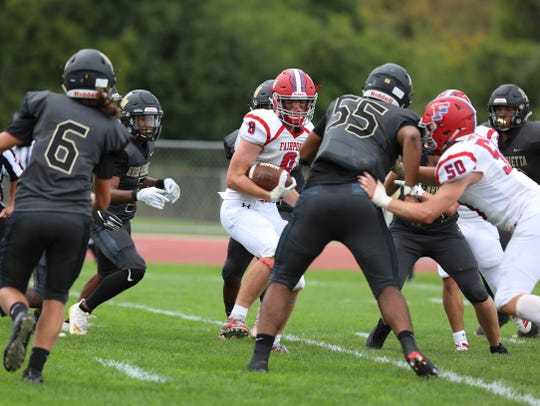 Fairport's Gavin Ingalls finds a small pocket to run through before getting tackled.
