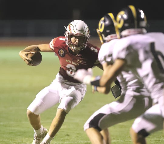 West Valley quarterback Kitt McCloughan carries the ball in his team's 42-28 win over Enterprise on Friday, Sept. 6, 2019.