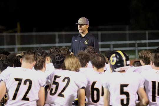 Enterprise head football coach Chris Combs talks to his players following his team's 42-28 loss to West Valley on Friday, Sept. 6, 2019.